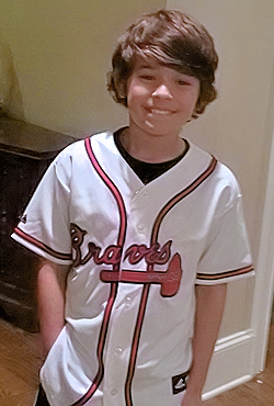 Gabriel, seen wearing his new Atlanta Braves jersey at his Atlanta home on December 17, 2014.